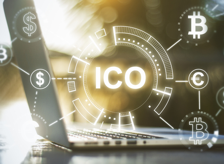 Photo pour Close up of notebook with abstract ICO hologram. Initial coin offering concept. Double exposure  - image libre de droit