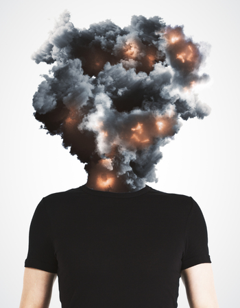 Foto de Man with abstract explosion smoke and fire head standing on white background. Disaster and stress concept  - Imagen libre de derechos
