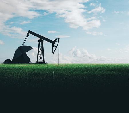 Photo pour Oil pumping machine in field. Mining and quarrying concept - image libre de droit