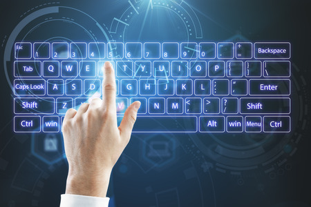 Foto de top view on businessman hand typing on virtual keyboard at abstract technology background. - Imagen libre de derechos