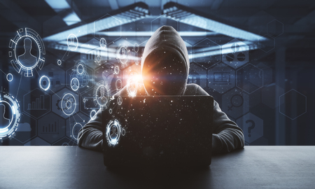 Foto de no face hacker working on laptop with technology digital cyberspace interface around at abstract background - Imagen libre de derechos