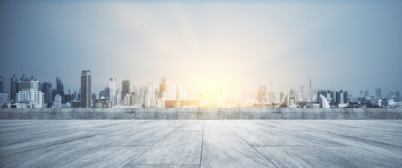 Foto de Concrete rooftop with beautiful sunset city view background - Imagen libre de derechos