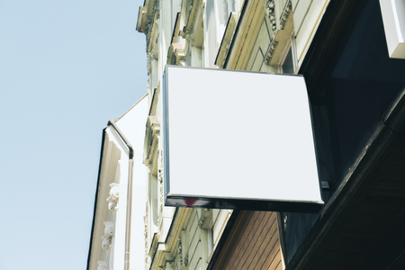 Photo for Empty square white signage on building with classical architecture and daylight. Mock up - Royalty Free Image