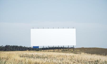 Photo pour Empty white billbaord in field. Commercial concept. Mock up - image libre de droit