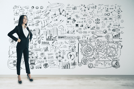 Photo pour Management and finance concept. Attractive young european businesswoman with business sketch on concrete wall background - image libre de droit