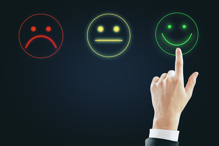 Photo for Hand with smiley rating on dark background. Excellent service concept - Royalty Free Image