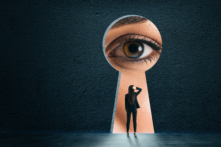 Photo for Abstract keyhole opening with businesswoman eye on concrete wall background. Access and vision concept - Royalty Free Image