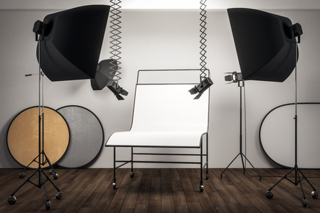 Photo for Modern photo studio interior with professional equipment and empty white background table. Mock up, 3D Rendering - Royalty Free Image