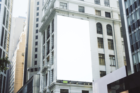 Foto de Empty white poster on city building. Public ad and commercial concept. Mock up - Imagen libre de derechos