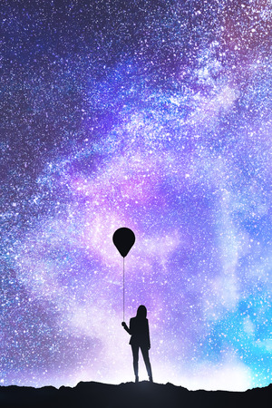 Photo pour Businesswoman silhouette with balloon standing on beautiful starry sky background. Freedom and success concept - image libre de droit