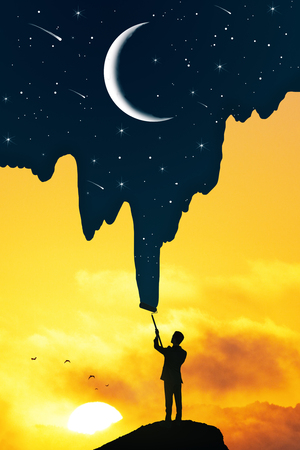 Foto de Businessman drawing beautiful starry sky and crescent on bright sunset background. Creativity and abstract concept - Imagen libre de derechos