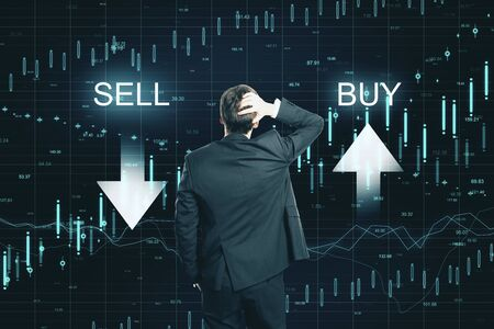 Foto de Back view of thoughtful businessman on creative buy sell forex chart background. Market and invest concept - Imagen libre de derechos