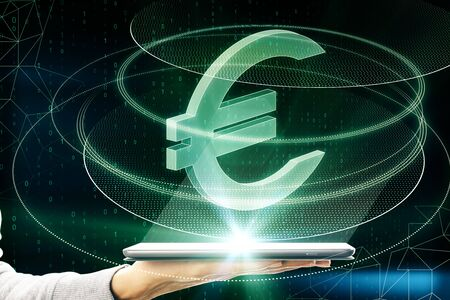 Foto de Hand holding smartphone with creative glowing green euro sign icon on dark background. Money, technology, e-commerce and cryptocurrency concept. Multiexposure - Imagen libre de derechos
