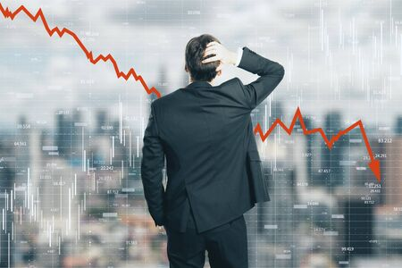 Foto de Back view of stressed young businessman looking at downward red arrow on blurry city background. Decrease, stats and economy concept. Multiexposure - Imagen libre de derechos