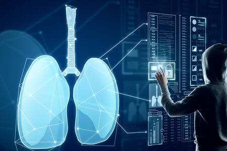 Photo pour Hacker with abstract glowing blue medical lungs interface background with icons. Medicine and innovation concept. Double exposure - image libre de droit