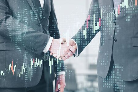 Photo for Business partnership with double exposure of handshaking men and abstract financial chart. - Royalty Free Image
