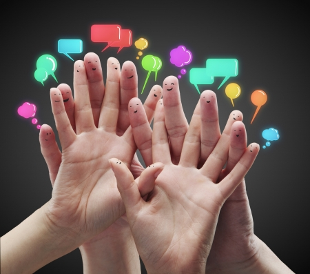 Foto per Happy group of finger smileys with social chat sign and speech bubbles - Immagine Royalty Free