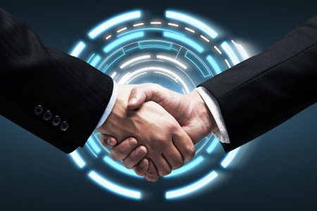 Photo for Handshake - Hands holding on background  a touch screen interface - Royalty Free Image