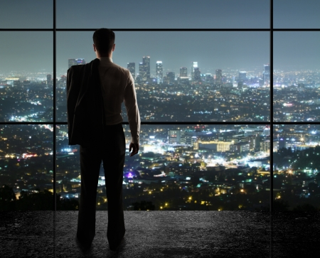 businessman looks in night city