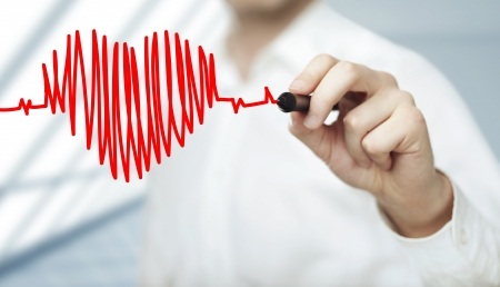 Foto de businessman drawing heart and chart heartbeat - Imagen libre de derechos