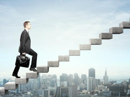 Photo pour Businessman stepping up a staircase and city - image libre de droit