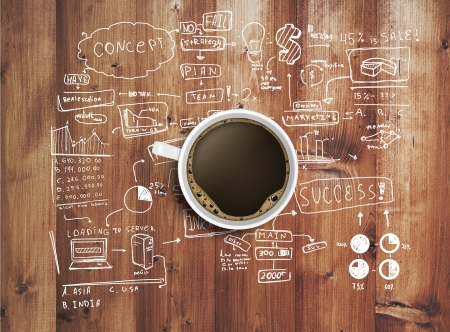 Photo for coffee cup and business strategy on wooden table - Royalty Free Image