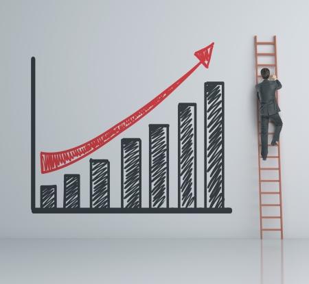 Foto de man climbing on ladder and chart - Imagen libre de derechos