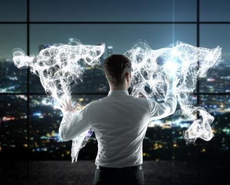 Photo pour businessman pushing world map on  interface - image libre de droit
