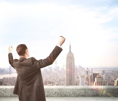 Foto de happiness businessman on roof skyscraper - Imagen libre de derechos