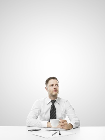 businessman sitting on table and thinking