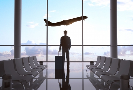 Foto de businessman in airport and airplane in sky - Imagen libre de derechos