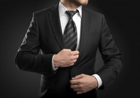Foto de businessman in suit  on black background - Imagen libre de derechos