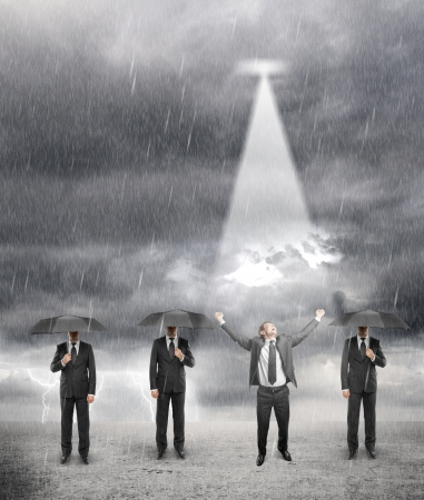 three businessman standing with umbrella and one happiness businessman in rainy weather