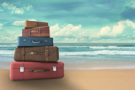 Foto de bags on beach, travel concept - Imagen libre de derechos