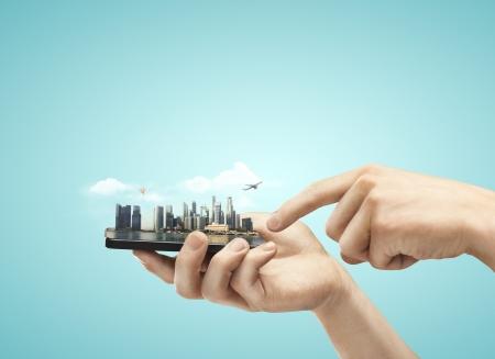 Foto de phone with model city in hands - Imagen libre de derechos