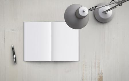 Foto de opened book on the table with white lamp - Imagen libre de derechos