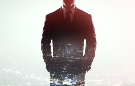 Photo pour businessman in coat on a city background - image libre de droit