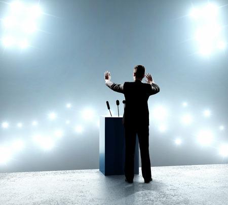 Photo pour businessman standing on podium and closes on outbreaks - image libre de droit