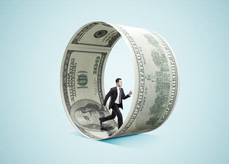 Photo pour businessman running in money wheel  on blue background - image libre de droit
