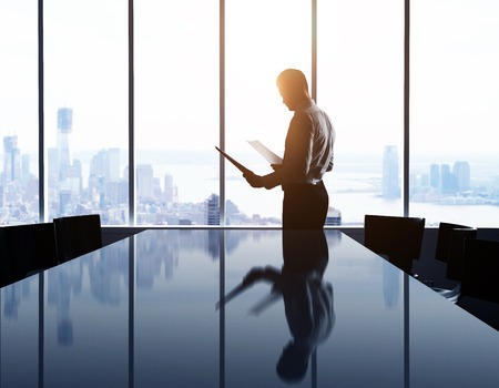 Photo pour businessman in office and city in window - image libre de droit