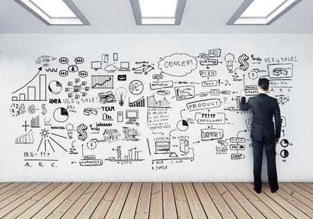 Foto de businessman drawing business concept on wall - Imagen libre de derechos