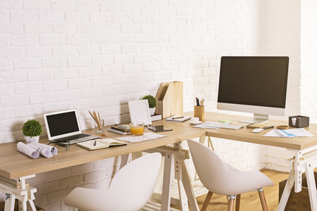 Photo for Creative designer workspace with blank laptop and computer screens in interior with wooden floor and white brick wall. Mock up - Royalty Free Image