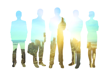 Business men and women silhouettes on city background with sunlight. Concept of teamwork and partnership. Double exposure
