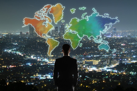 Travel concept with businessman looking at colorful map on illuminated night city background