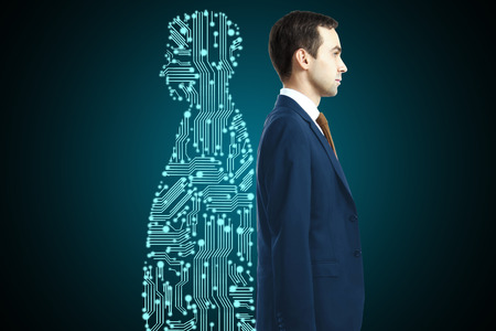 Foto de Businessman with digital partner standing back-to-back on dark background - Imagen libre de derechos