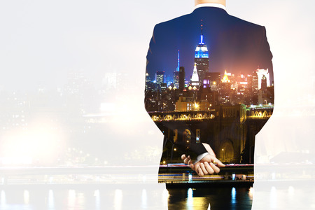 Back view of man in suit on night city background with copy space. Double exposure