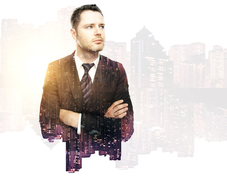 Thoughtful handsome business man on city background. Double exposure.