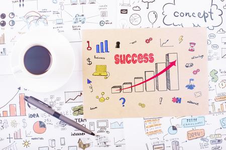 Photo pour Top view of desktop with business sketch, supplies and coffee cup. Success concept - image libre de droit