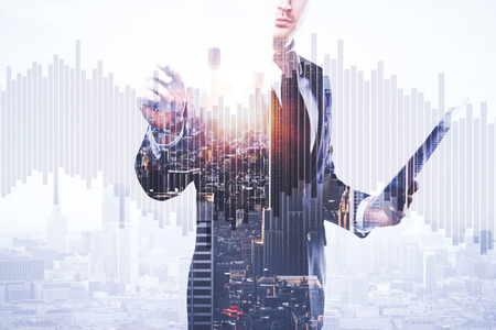 Foto de Businessman with document in hand drawing abstract business chart bars on bright city background. Trade concept. Double exposure - Imagen libre de derechos
