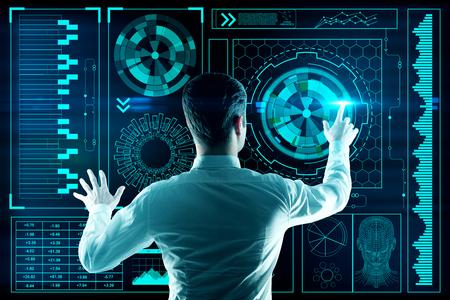 Foto de Back view of young busiessman using abstract digital interface. Analytics concept. 3D Rendering - Imagen libre de derechos